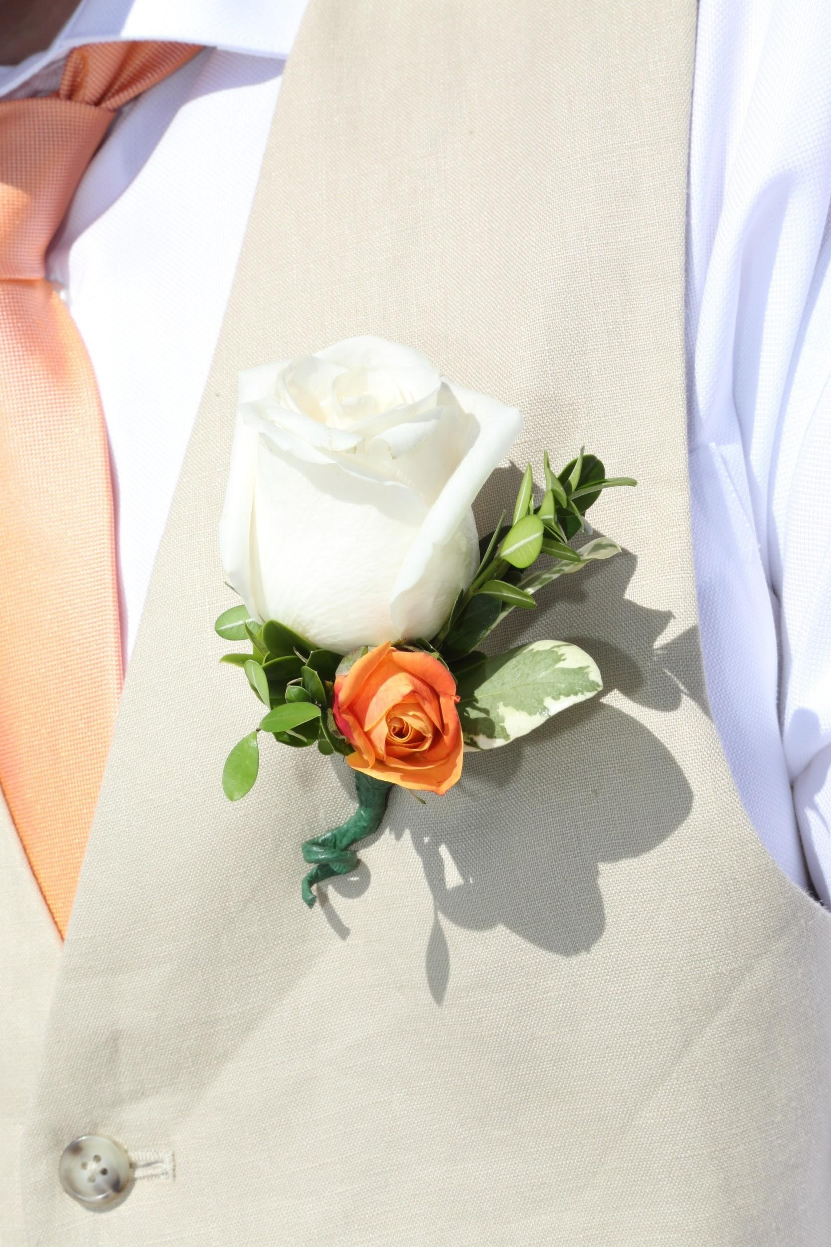 The groom had a touch of peach to match the bridal bouquet