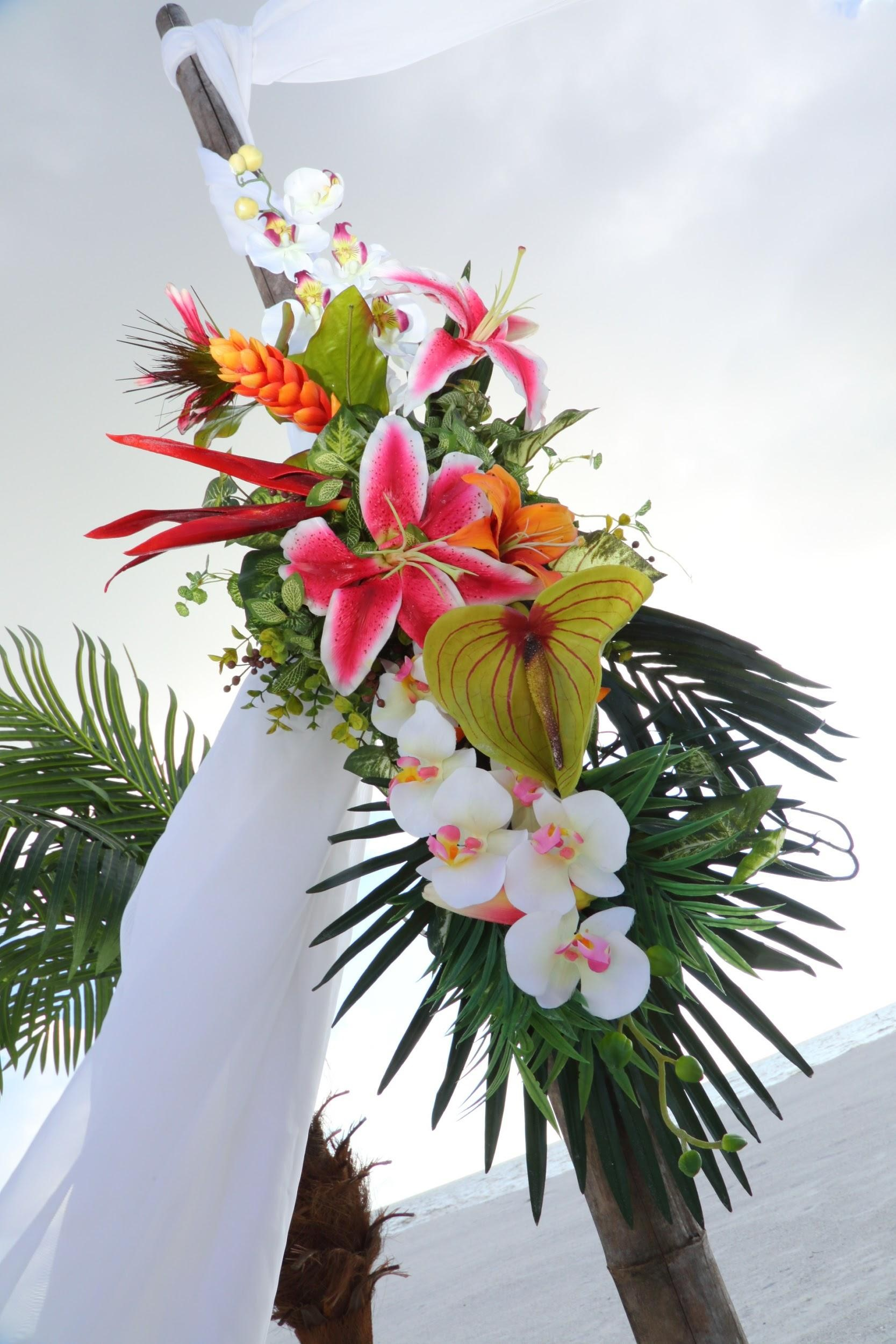 We just love these stunning tropical flowers for the ceremony arch!