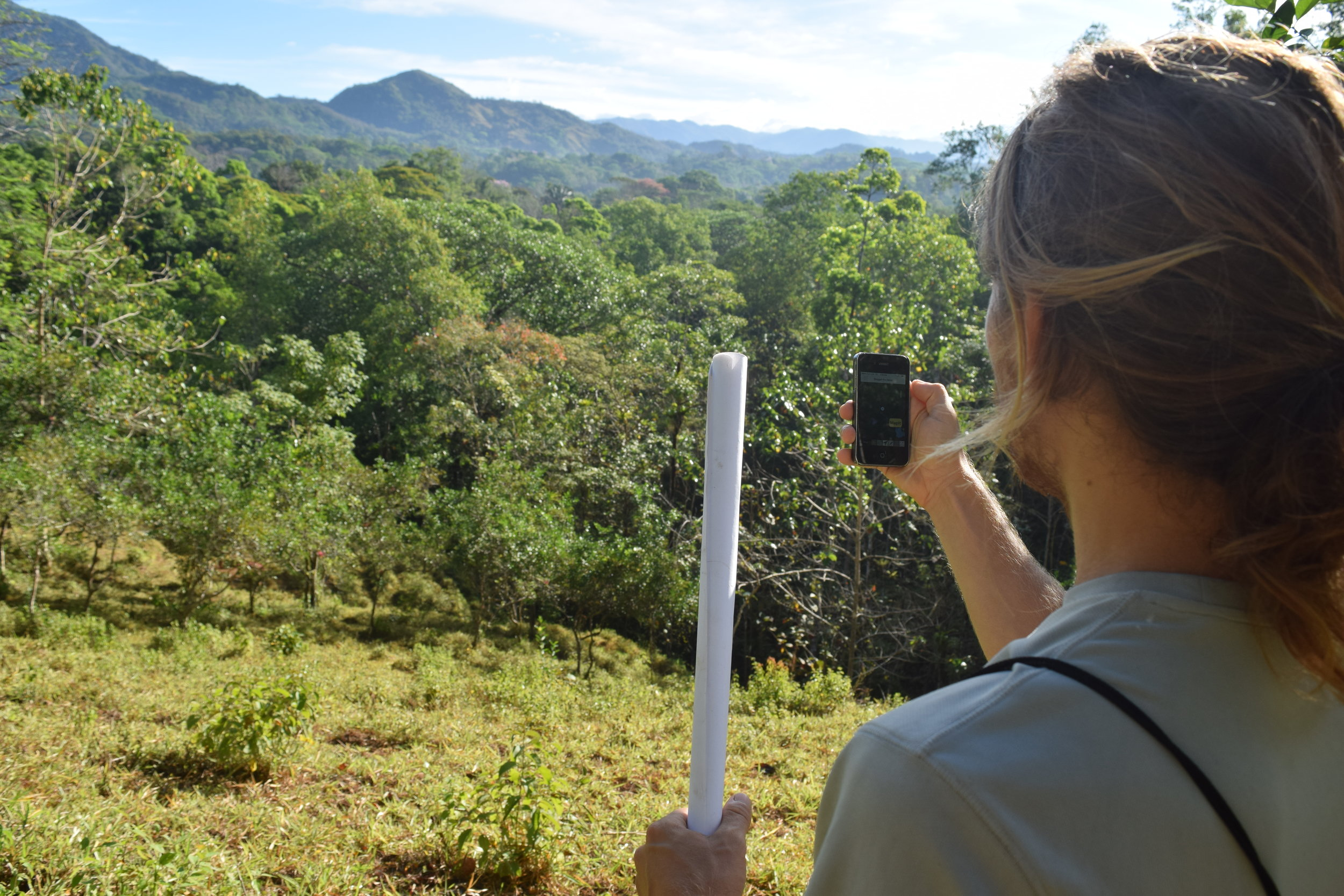 Scott Gallant maps a landscape with a phone app. (Photo Credit Laura Killingbeck; Mastatal, Costa Rica; of Scott Gallant)