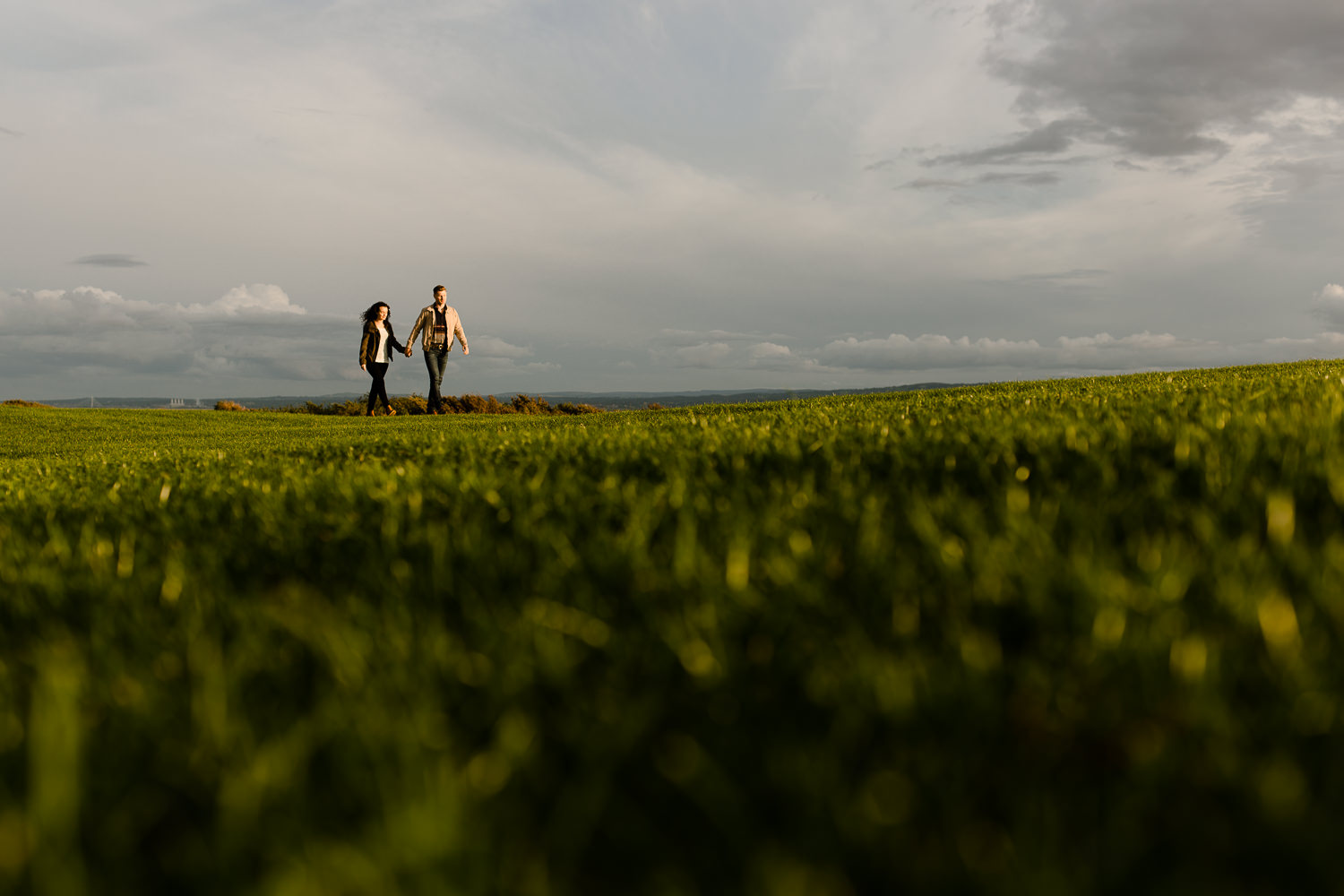 A couple stroll at Sunset in Wirral Country park- Merseyside