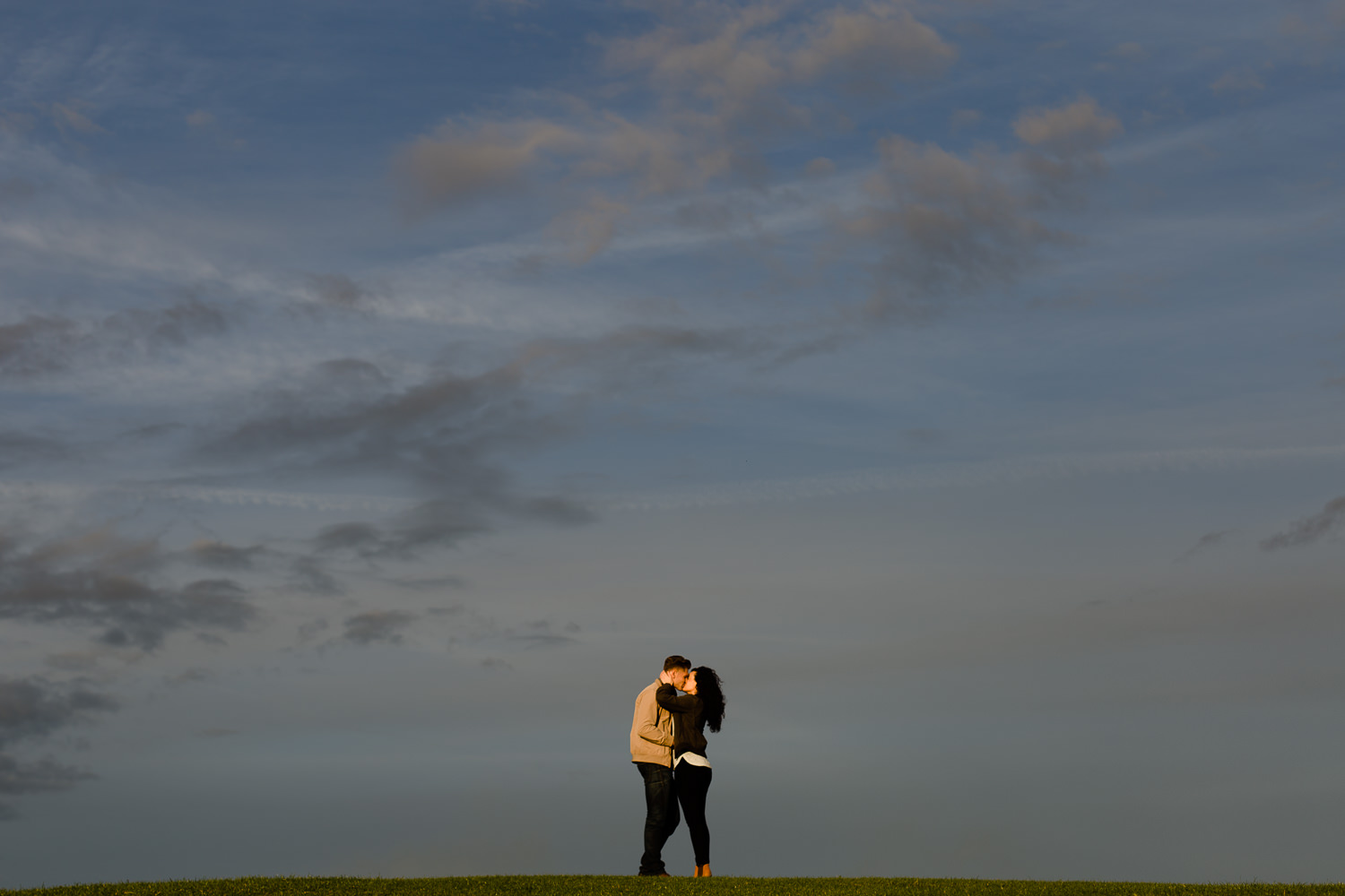 Golden Hour sky with a couple on a hill in Wirral Country Park - Merseyside wedding photography