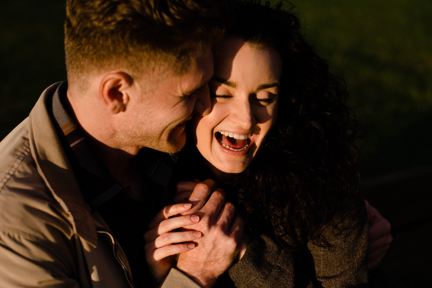 Close shot of a couple holding hands and laughing - Relaxed and fun pre wedding shoot