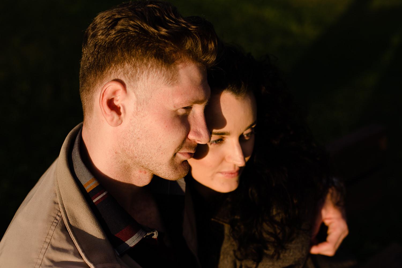 Kate & Anton cuddling in close watching the sunset - Merseyside wedding photographers