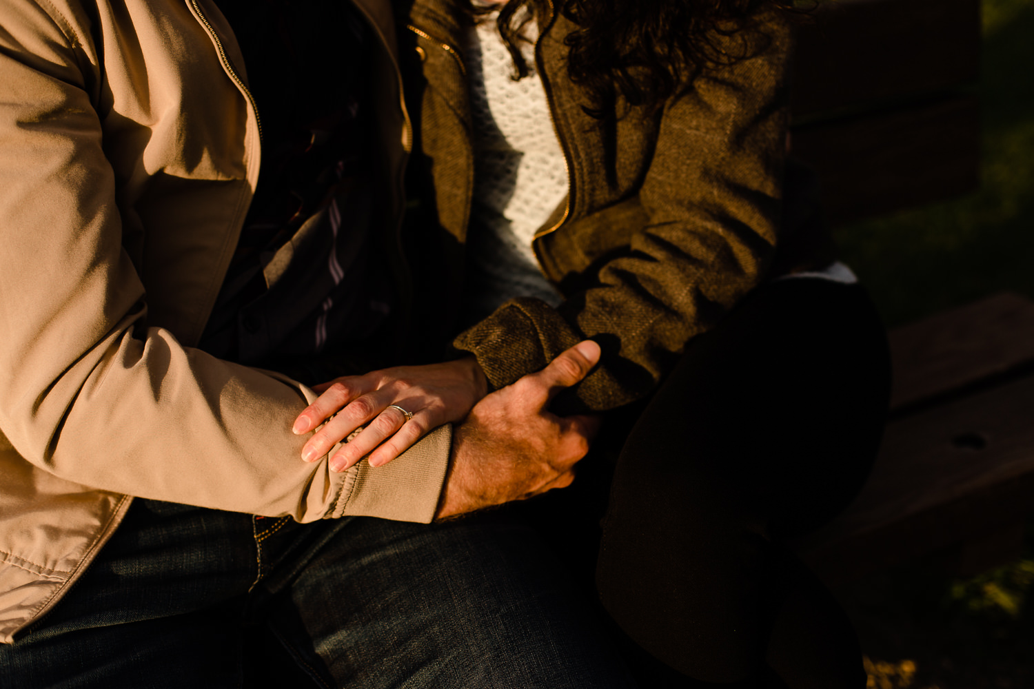 Close shot of a couples hands holding