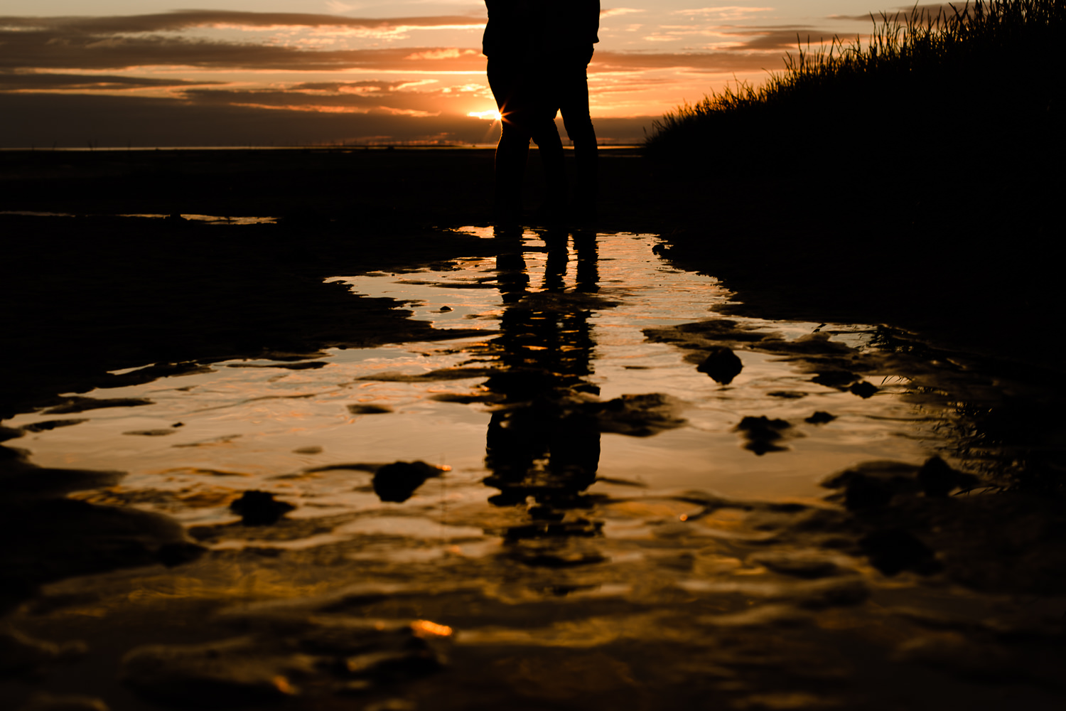 Silhouette and reflection of a couple on a wet beach - Wirral Country Park, Merseyside, Pre Wedding Shoot at Sunset