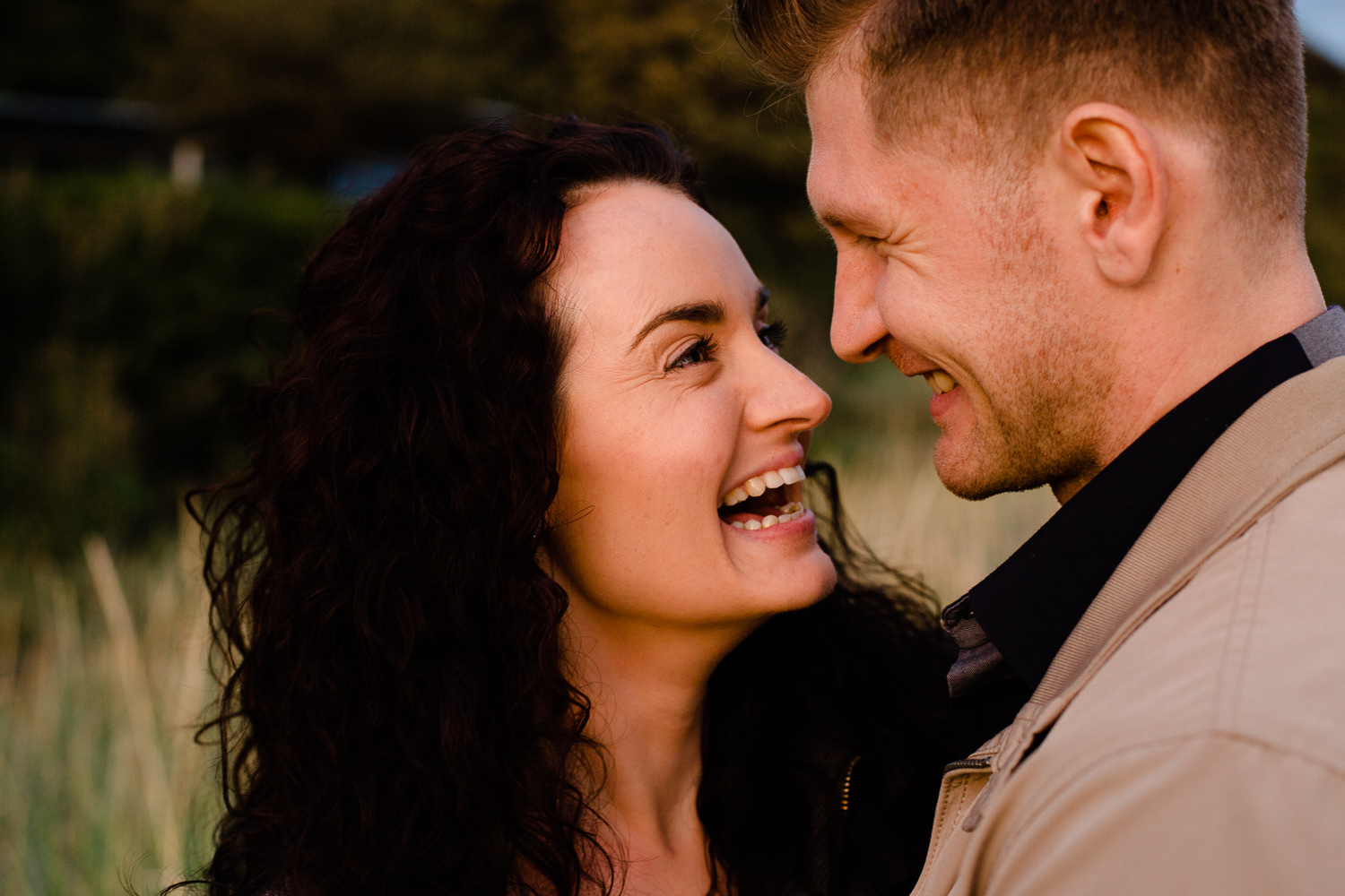 A couple looking at each other and laughing together