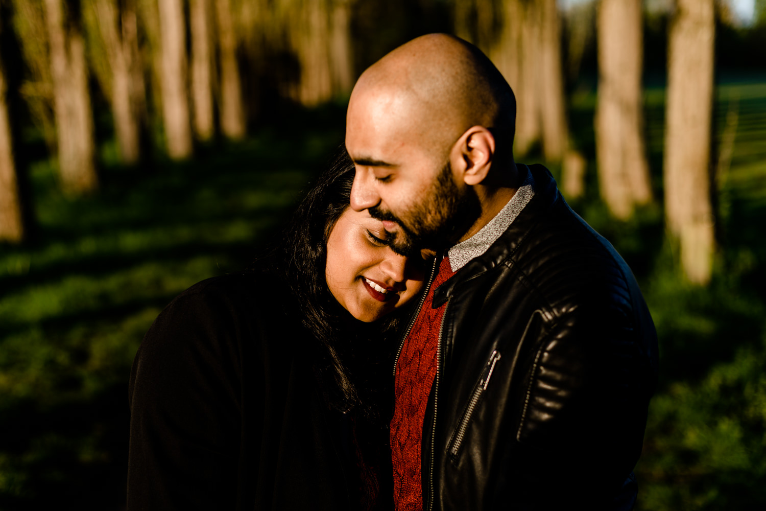 Couple cuddling on their pre wedding shoot at sunrise in Manchester