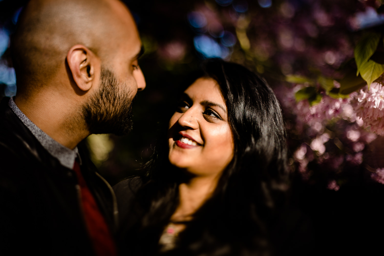 Freelensing image of a Hindu woman looking into her partners eyes on an engagement shoot.