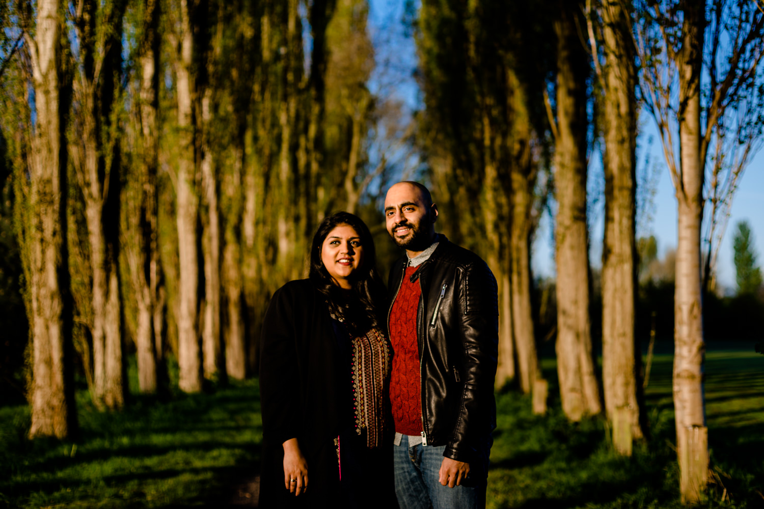 Hindu couple stood between trees at sunrise on a pre wedding shoot in Manchester