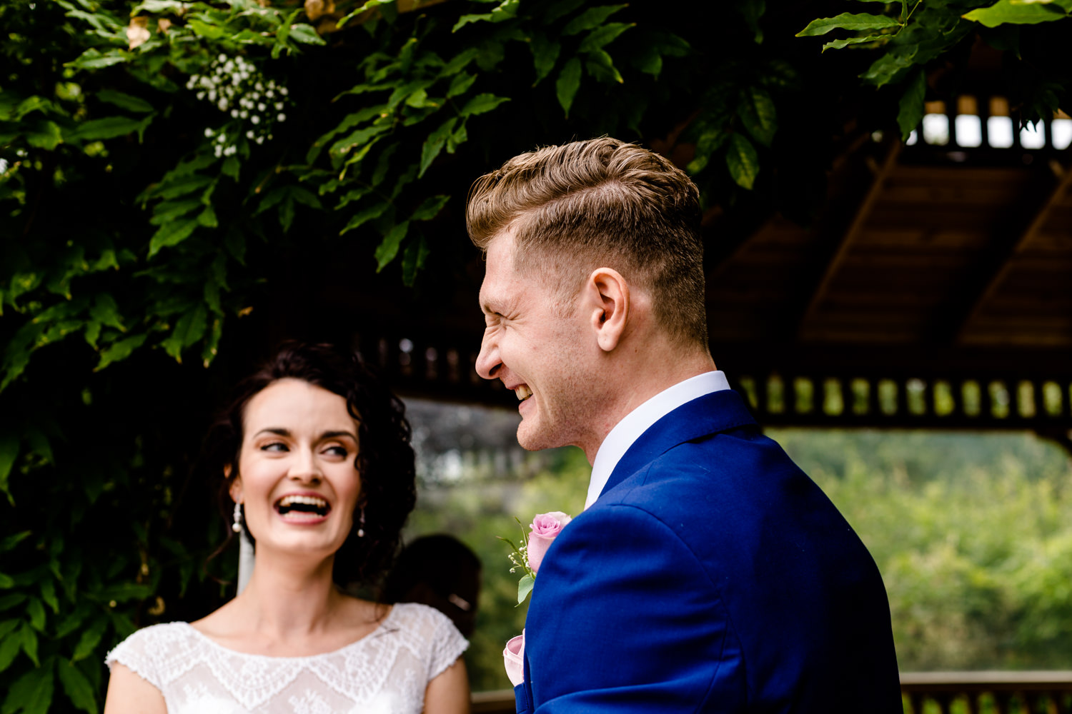 Laughing bride and groom at their Pryors Hates outdoor ceremony.