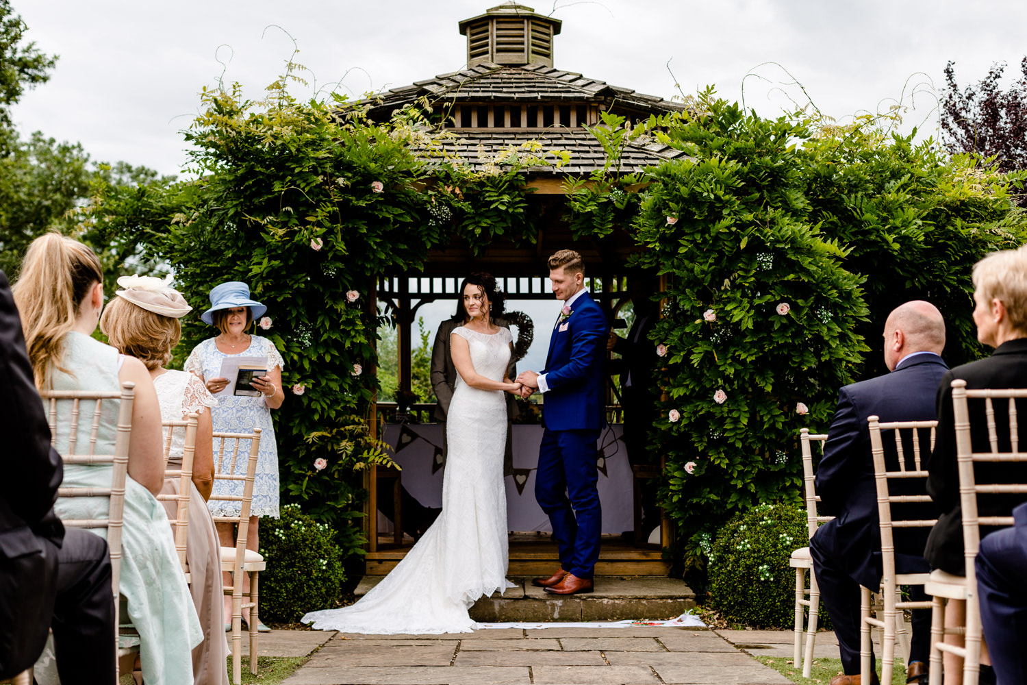 Outdoor wedding ceremony at Pryors Hayes in Cheshire.