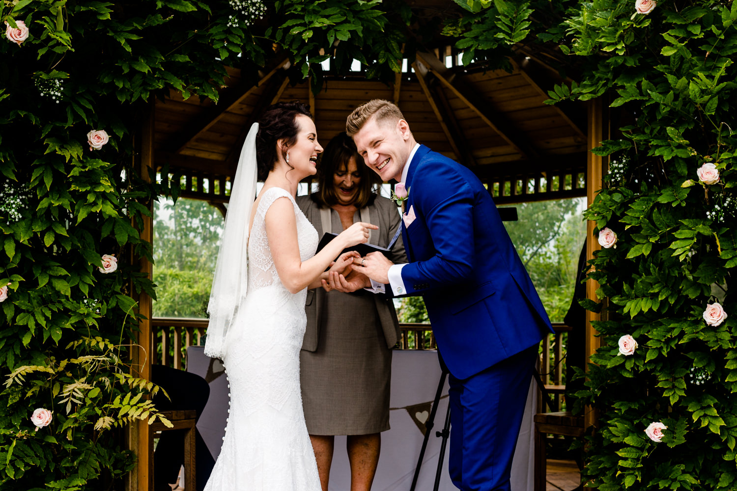 Bride and Groom laughing at their wedding ceremony in Cheshire.