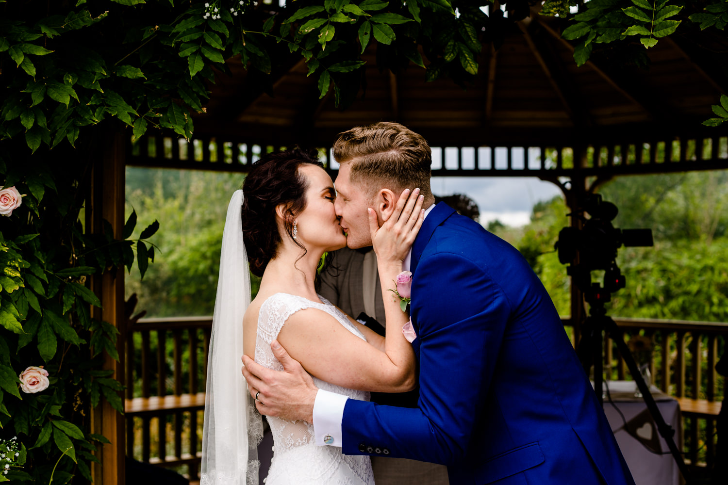 A bride & grooms first kiss at their Pryor Hayes wedding in Cheshire.