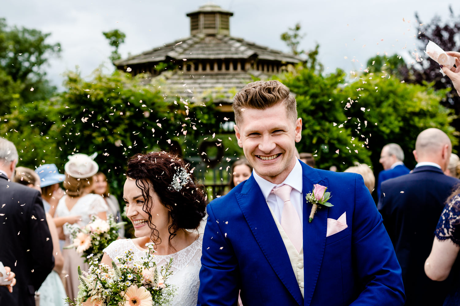 Confetti being thrown over a couple as they walk up the isle, wedding photography at Pryors Hayes Venue.