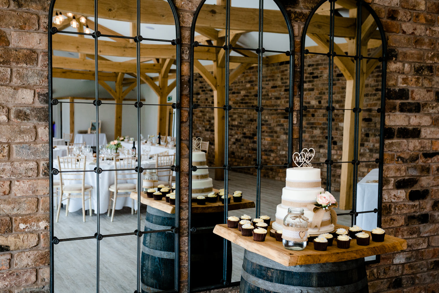 Mirrored wall and wedding cake at Pryor Hayes venue, Cheshire