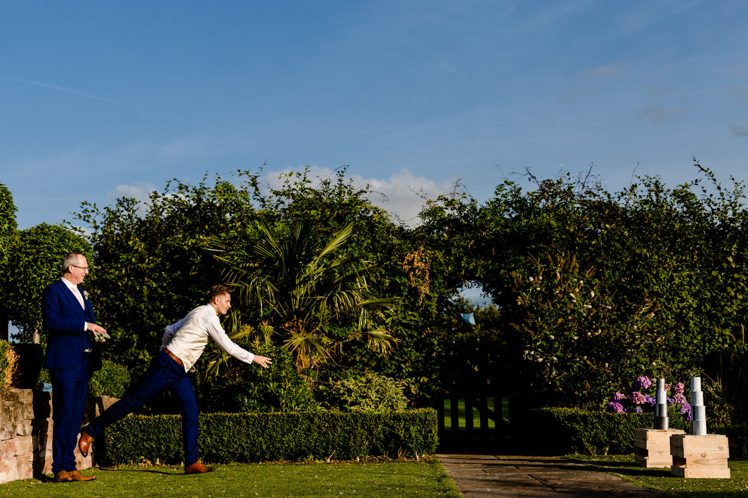 Pryor Hayes in Cheshire's wedding garden, a groom playing lawn games.