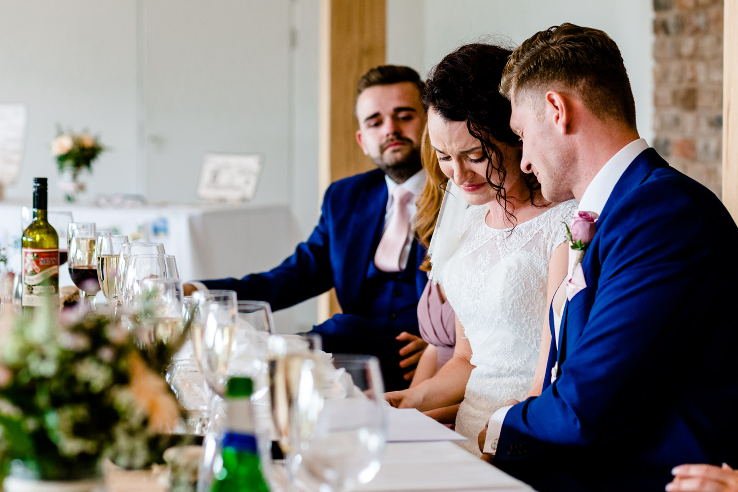 Bride crying at the speeches at her wedding in Cheshire.
