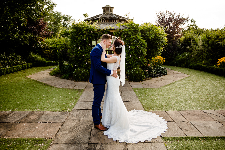 A wedding couple stood in Pryors Hayes wedding garden.