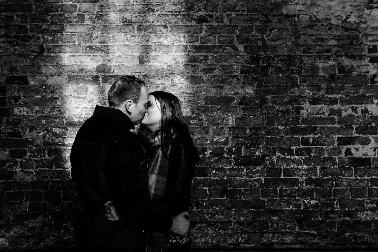 Kissing couple in window light at Dunham Massey.