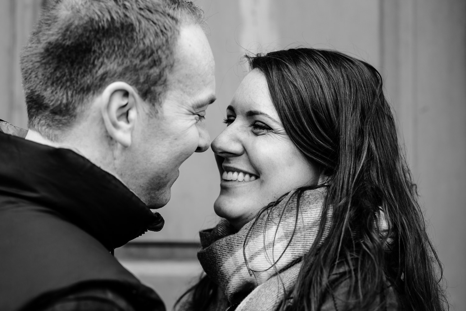 Close up of a giggling couple on a pre wedding shoot.