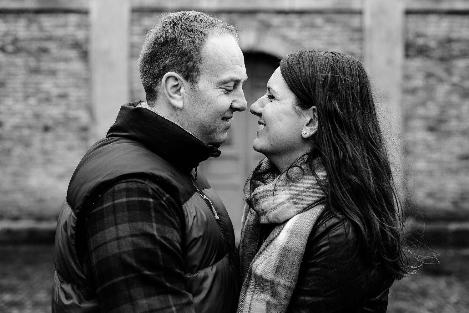 Black and white photo of a couple facing each other on their pre wedding shoot at Dunham Massey park.