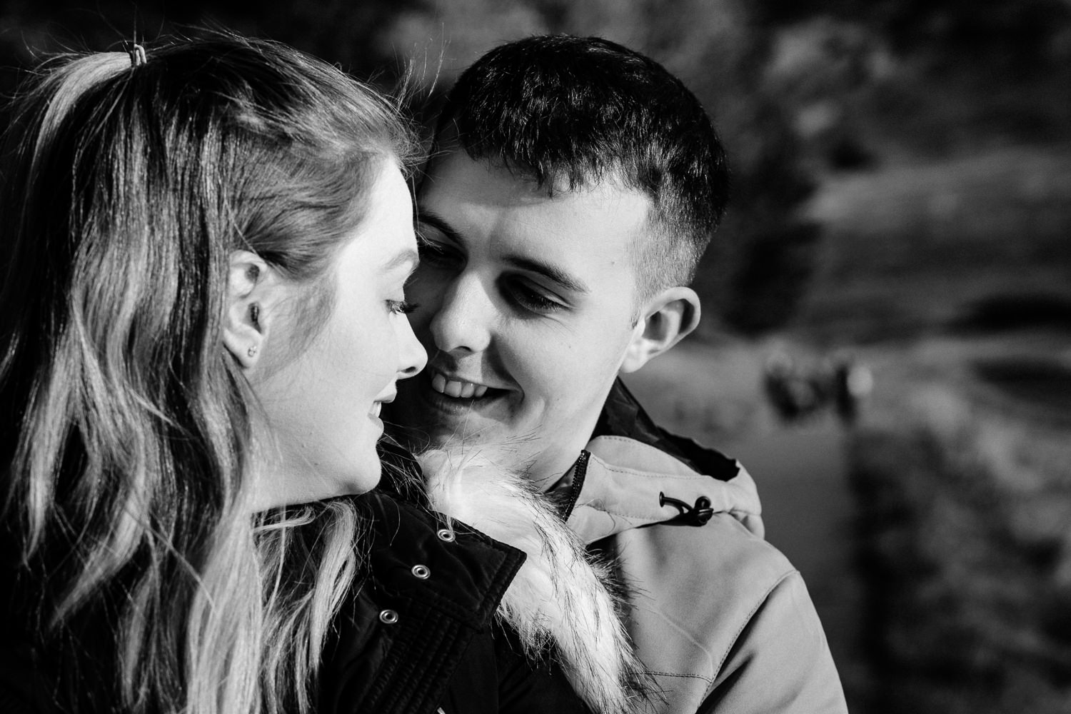 A black and white close up of a couple smiling on their pre wedding shoot.