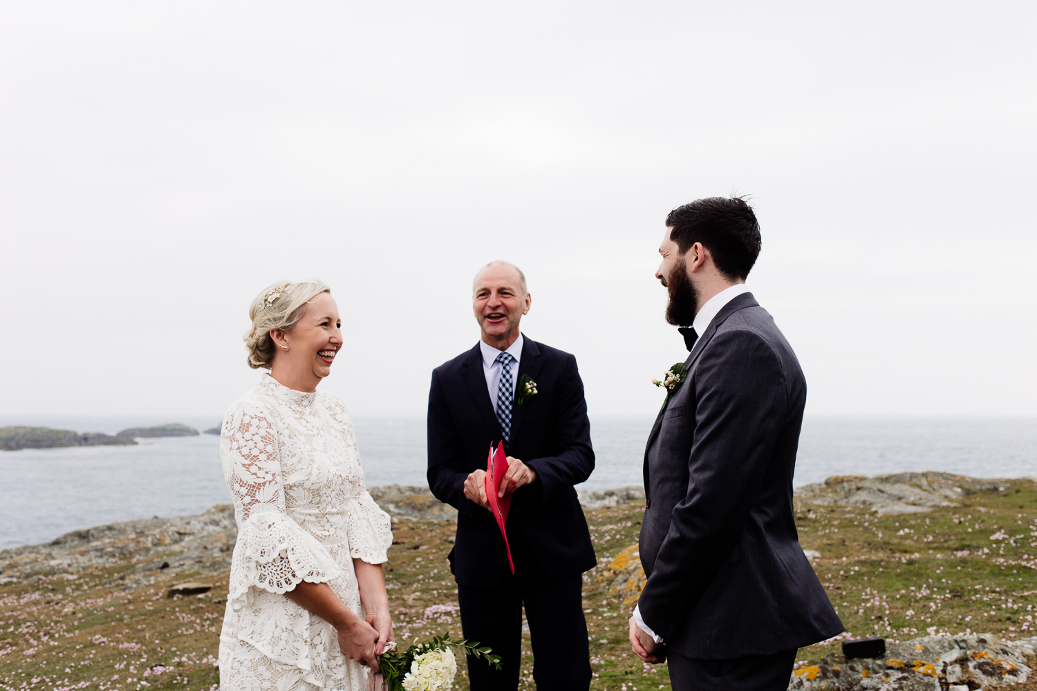 Outdoor ceremony on the Anglesey headland by Wales wedding photographers, About Today Photography.