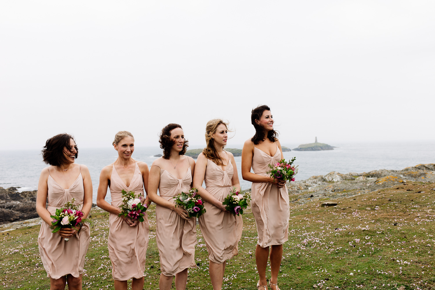 Bridesmaids at an outdoor ceremony on the Anglesey headland by Wales wedding photographers, About Today Photography.