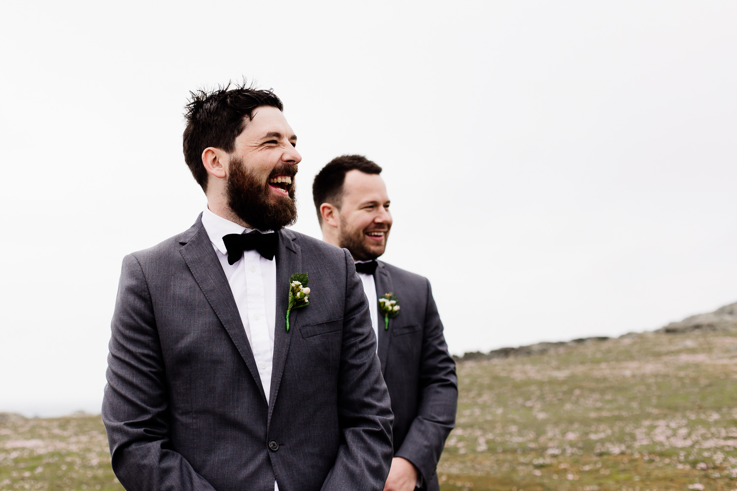 Groom laughing at his wedding in Anglesey, Wales.