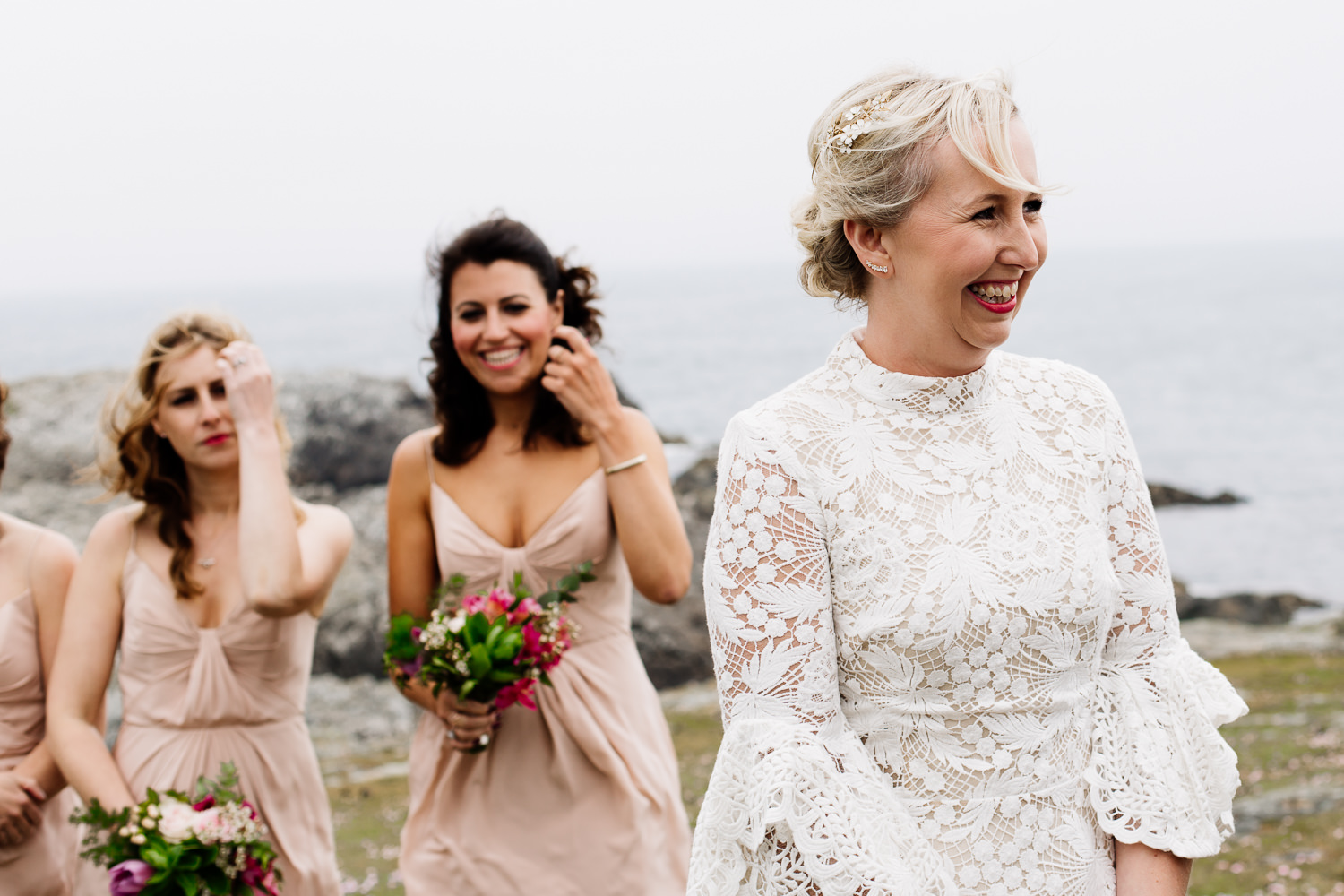 Bride in her lace dress at her Anglesey outdoor ceremony, Wales wedding photographer.