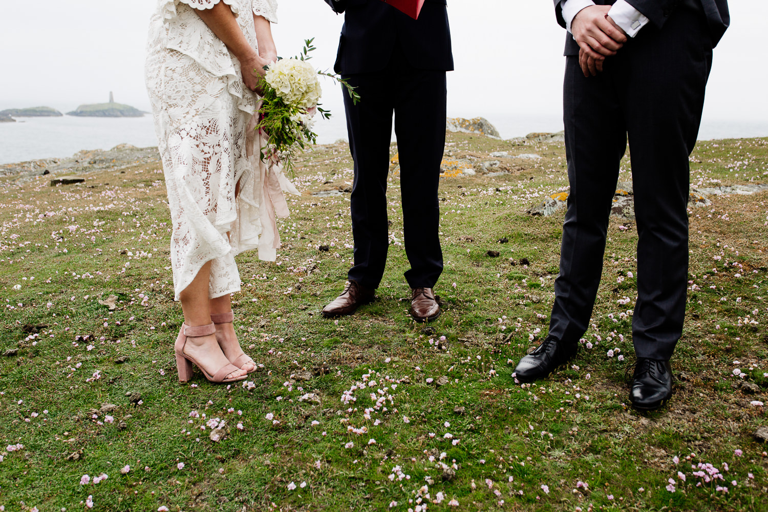 Detail of a bride and groom's feet at their outdoor tipi wedding ceremony in Anglesey, Wales.