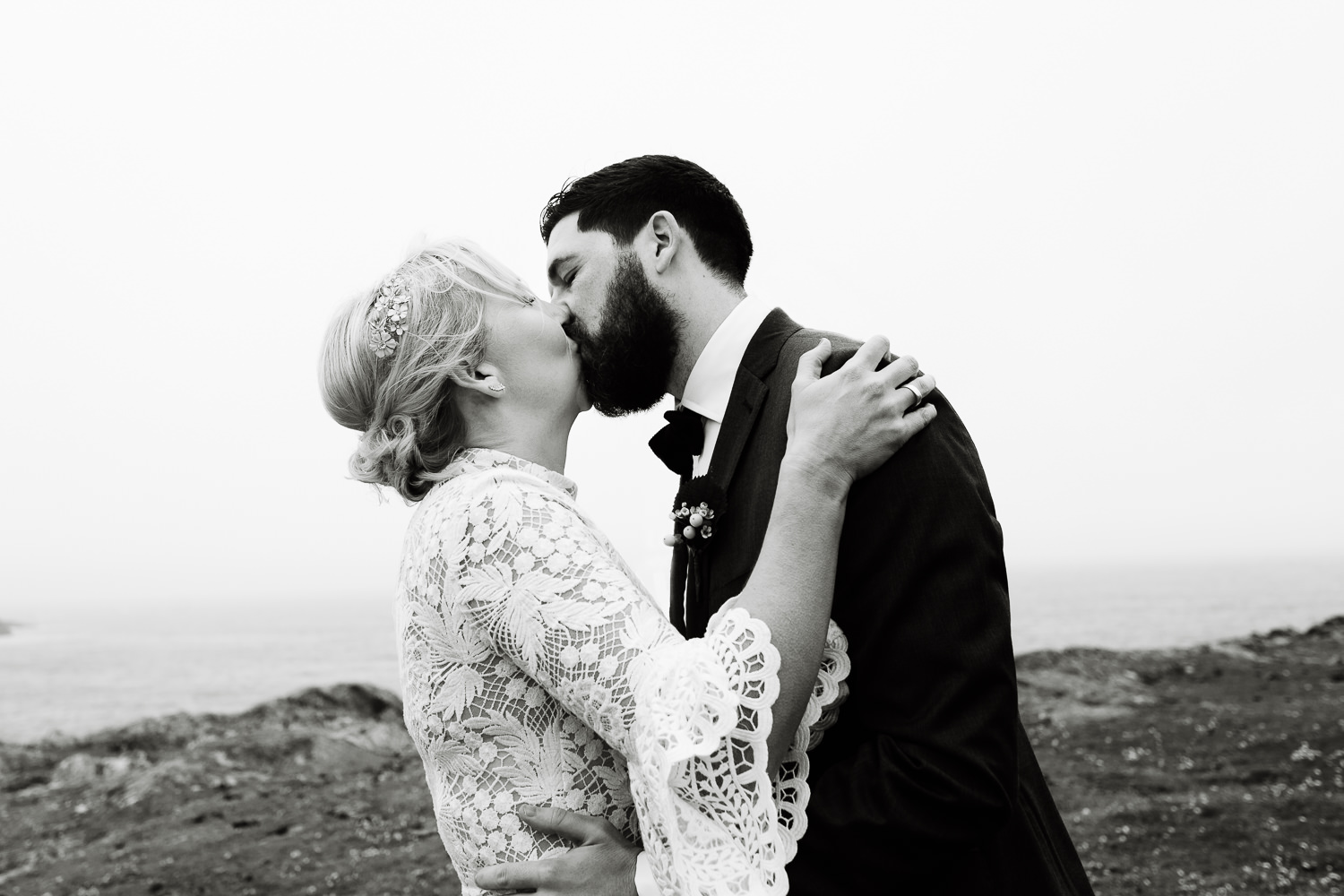 A bride and grooms first kiss, Wales wedding photography.