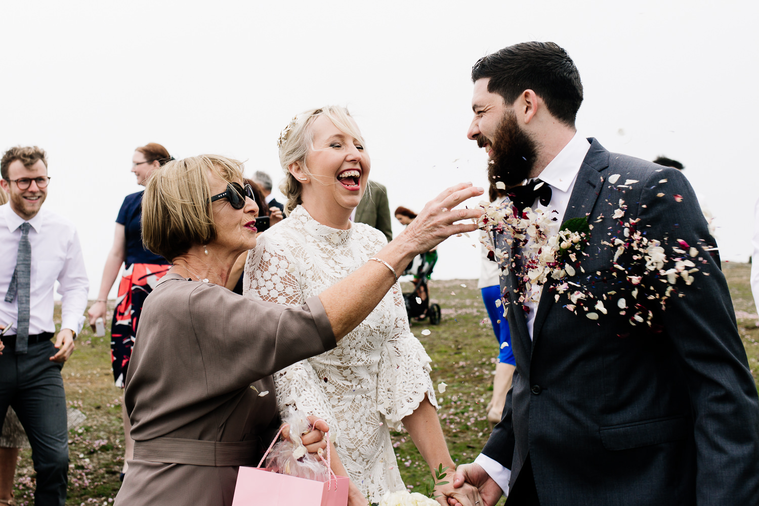 Confetti being thrown at a groom, by Wales wedding photographers, About Today Photography.