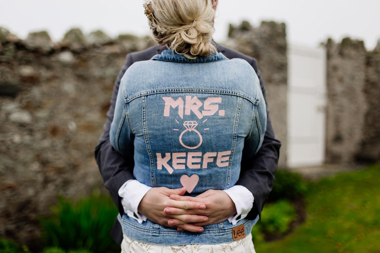 Bespoke wedding denim jacket with painted writing on the back.