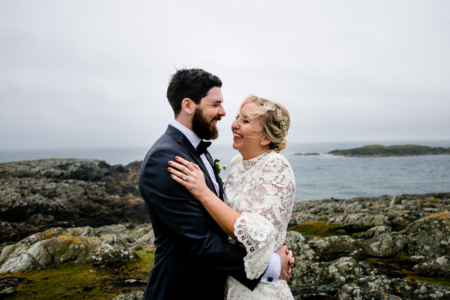 Wales Wedding Photographer, a bride and groom on the cliffs of the headland in Anglesey.