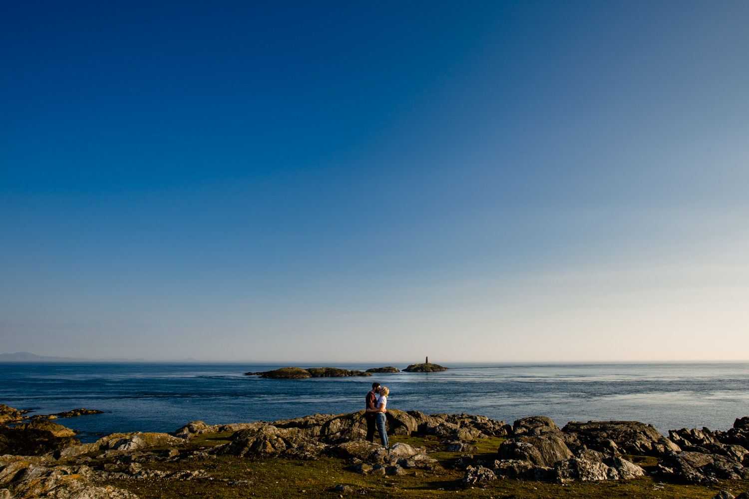 A view from the headland looking out to sea, from Kate & Sean's sunny pre wedding shoot on Holy Island, by Anglesey wedding photographers Zoe & Tom