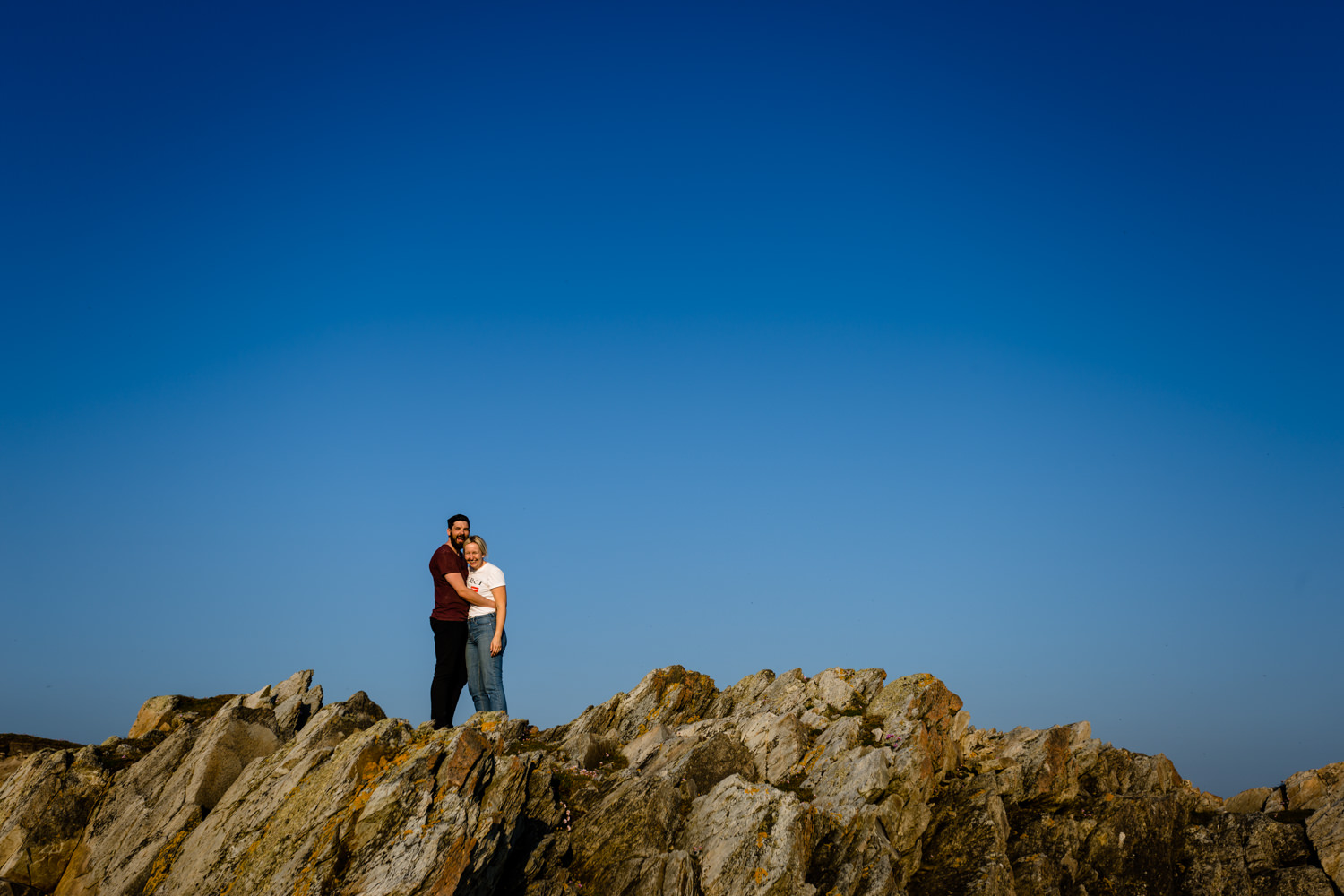 Pre wedding shoot on the rocky cliffs of the Rhoscolyn headland, by wedding photographers About Today Photography.