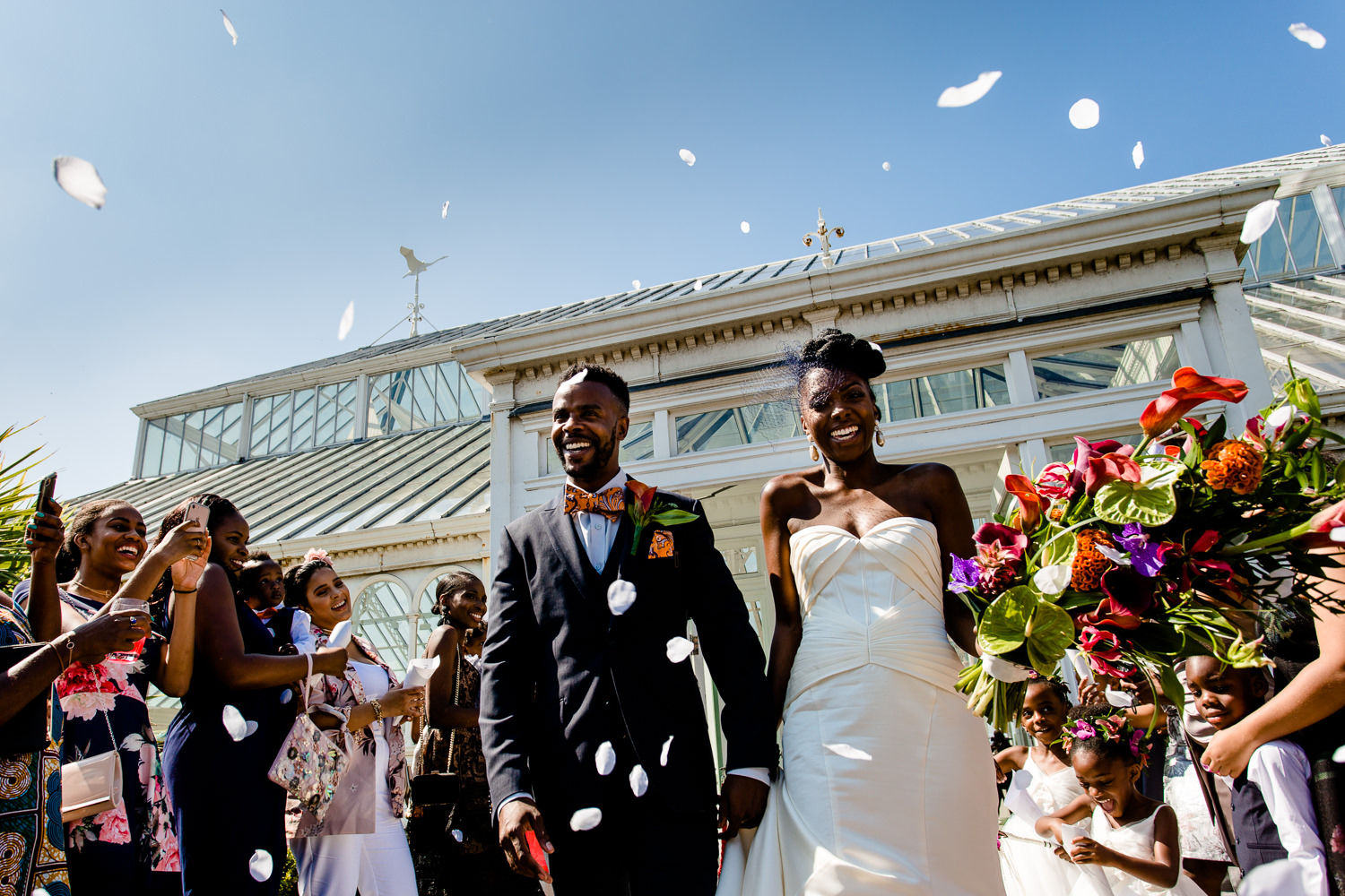 Bride and groom confetti shot outside The Isla Gladstone on a sunny wedding day at a Liverpool wedding.