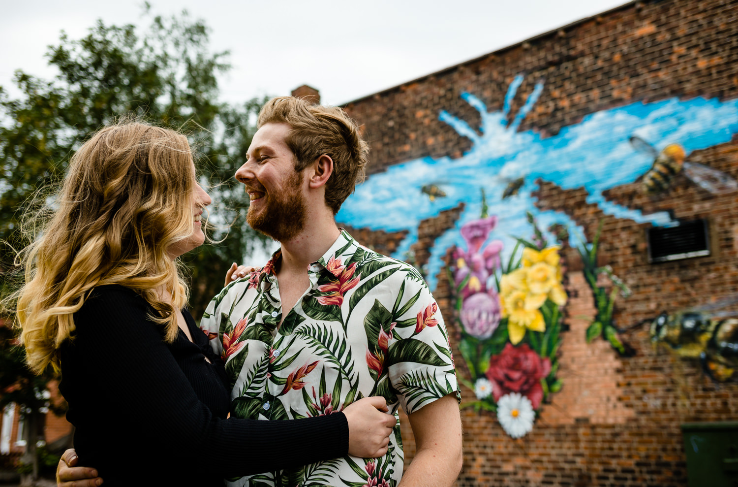 Colourful pre wedding shoot, featuring a brightly coloured Manchester Bee wall mural in Monton.