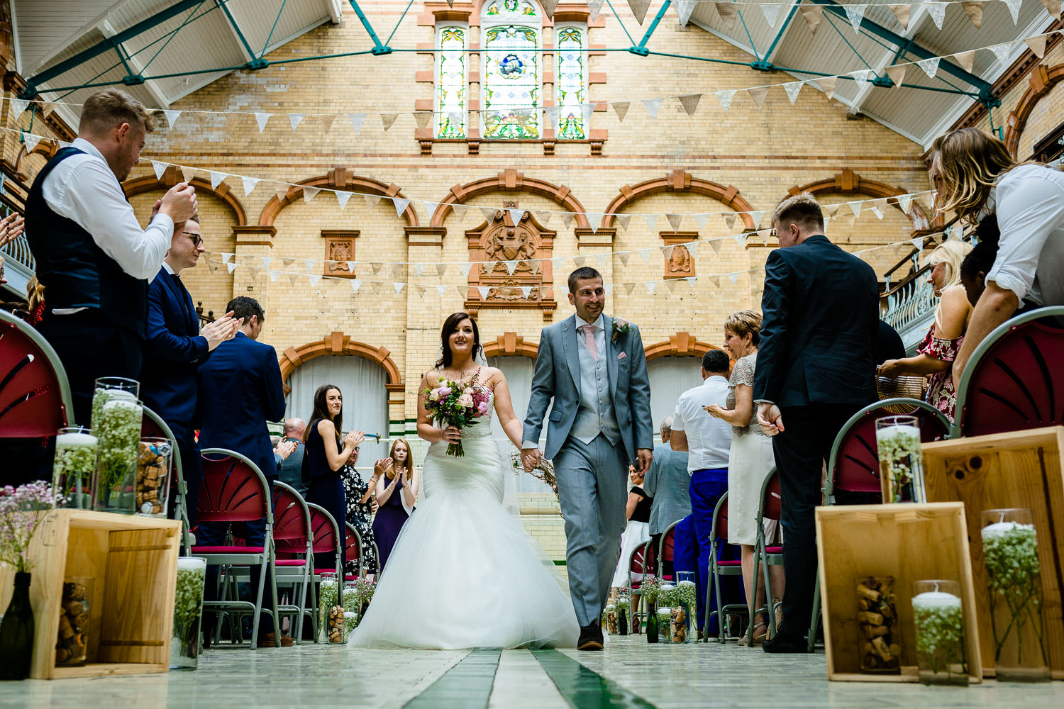 Victoria Baths wedding photographer, Kirsty & Kirk walk up the aisle as Mr & Mrs.