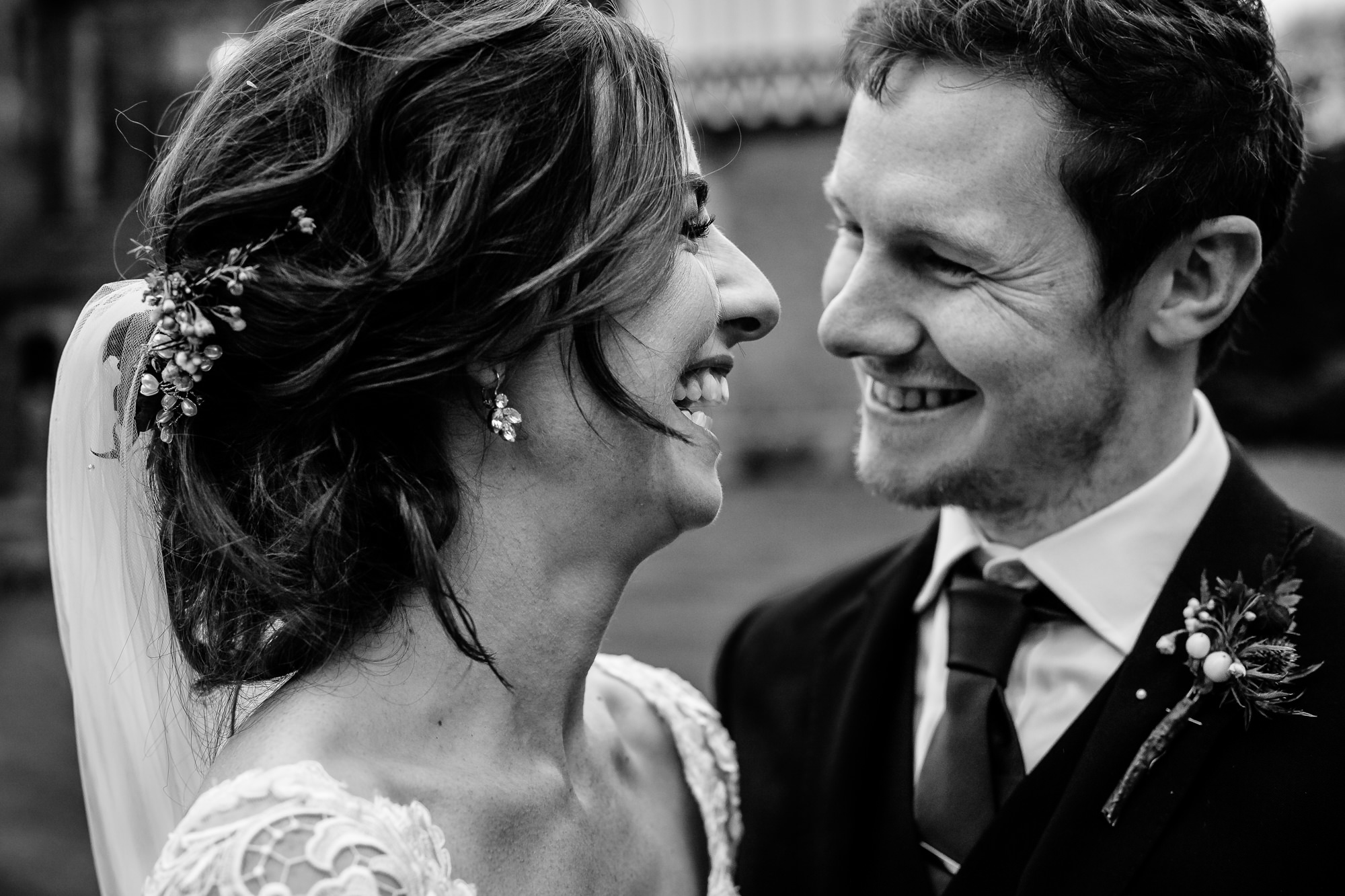 Close up of a bride and groom laughing on their wedding day at Tyn Dwr Hall