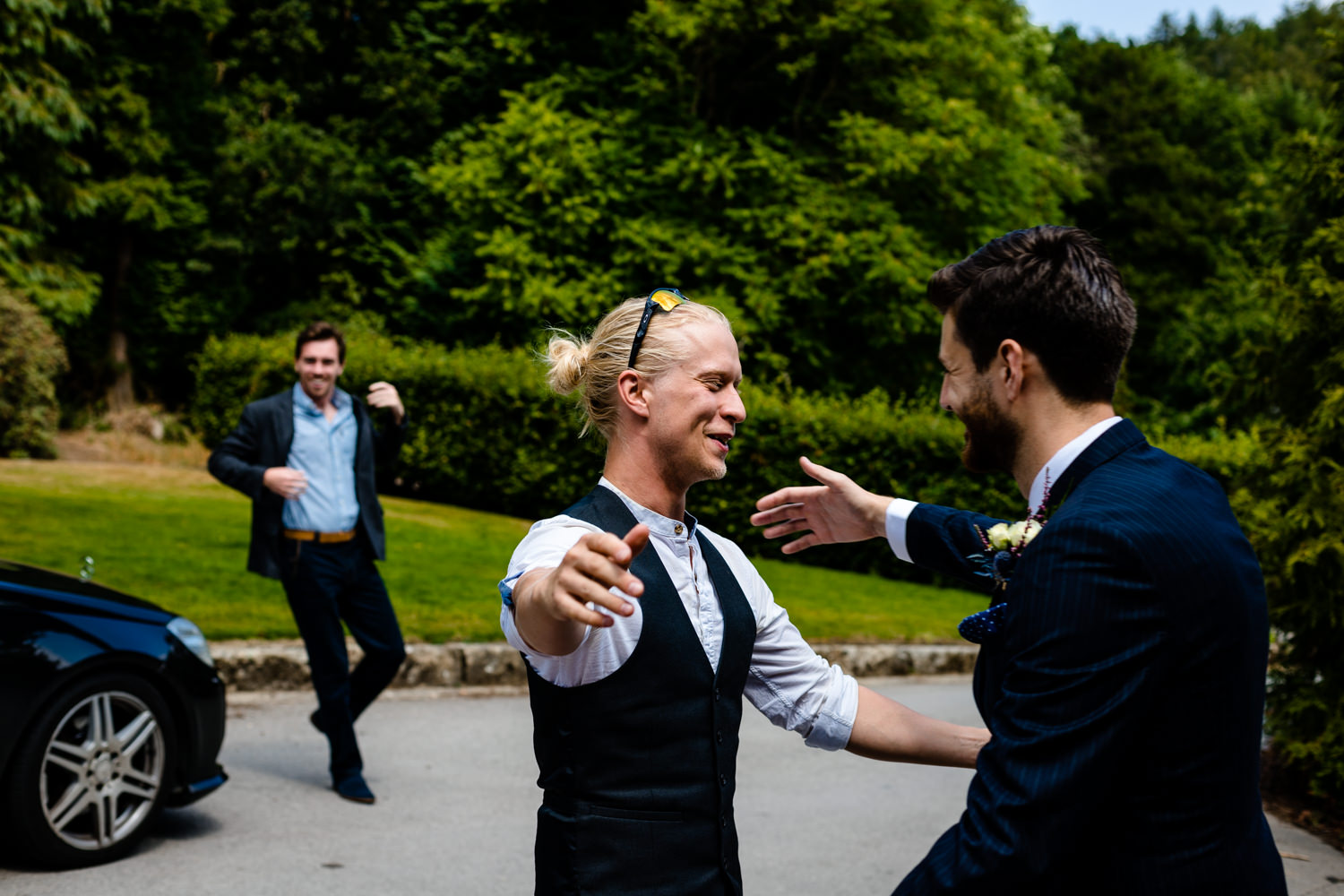 Guests greet the groom outside Whirlowbrook Hall.