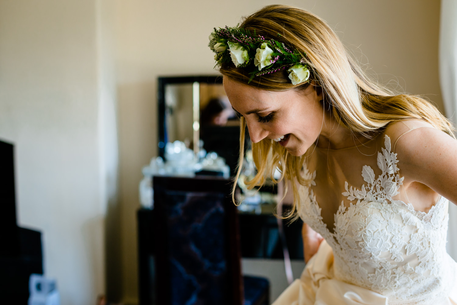 Bride putting on her Mori Lee wedding dress Colourful Whirlowbrook Hall photo