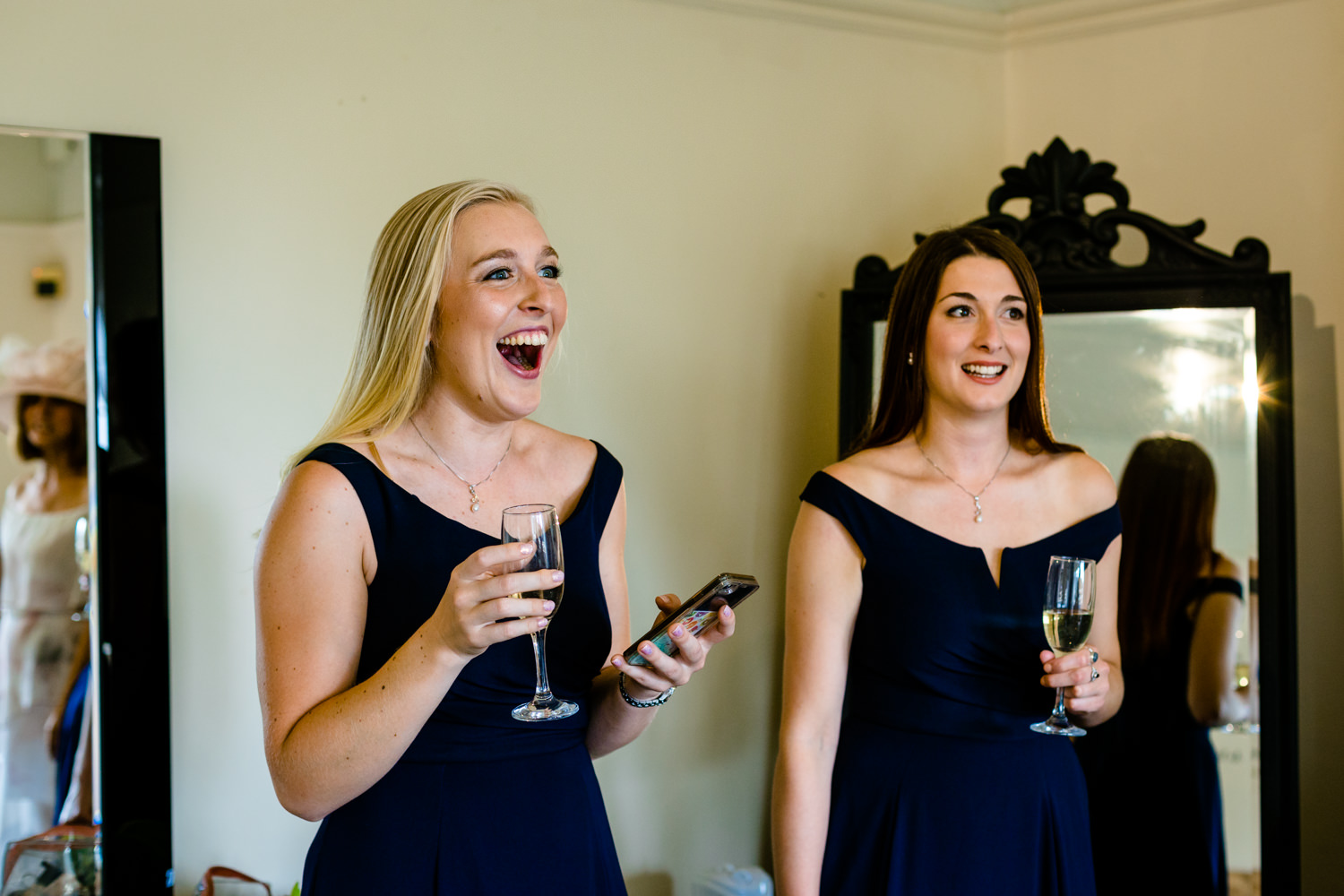 Laughing bridesmaids, relaxed Whirlowbrook Hall photography