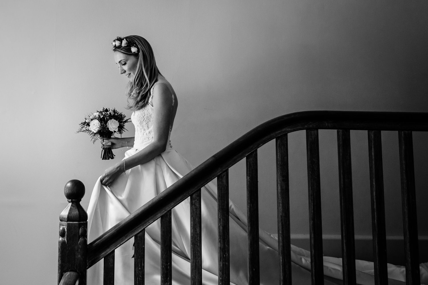 Whirlowbrook Hall weddingphotographer, a Mori Lee bride coming down the stairs
