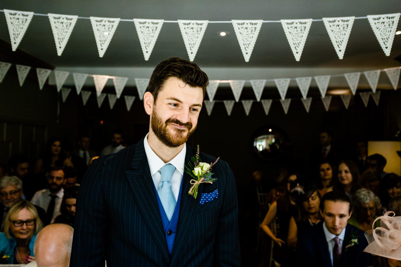 A groom awaits his bride.