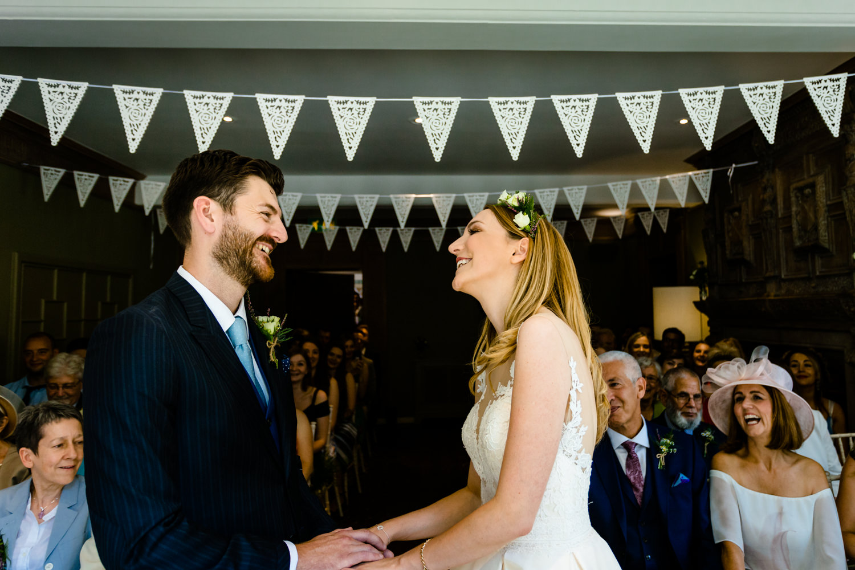 A bride and groom say I do,  Colourful Whirlowbrook Hallphotos