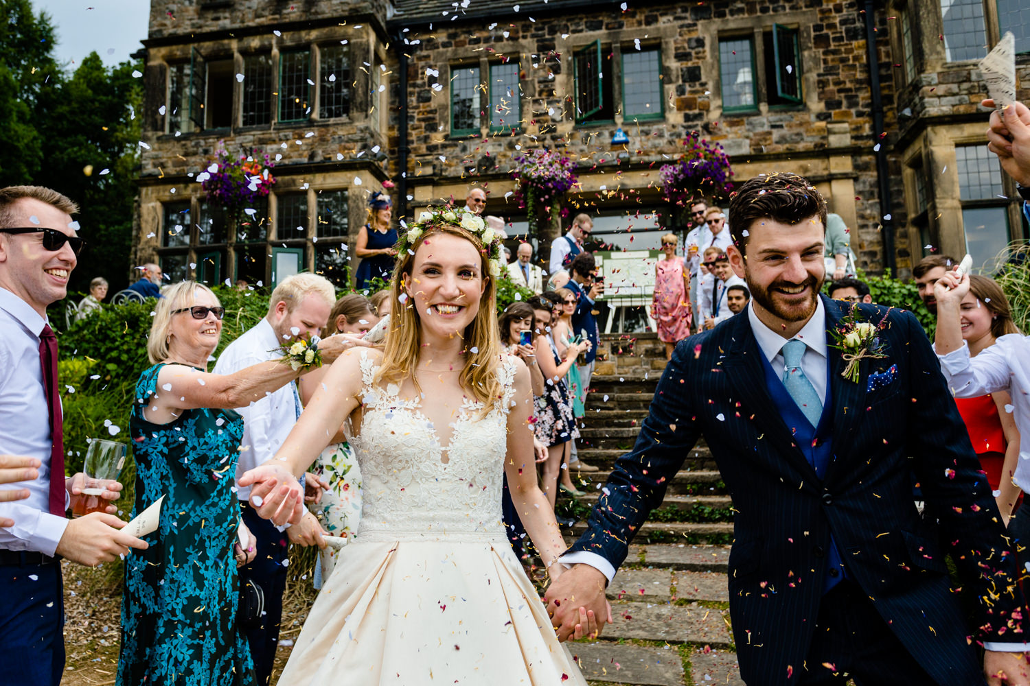 Confetti being thrown at a bride and groom, Whirlowbrook Hall wedding photo.