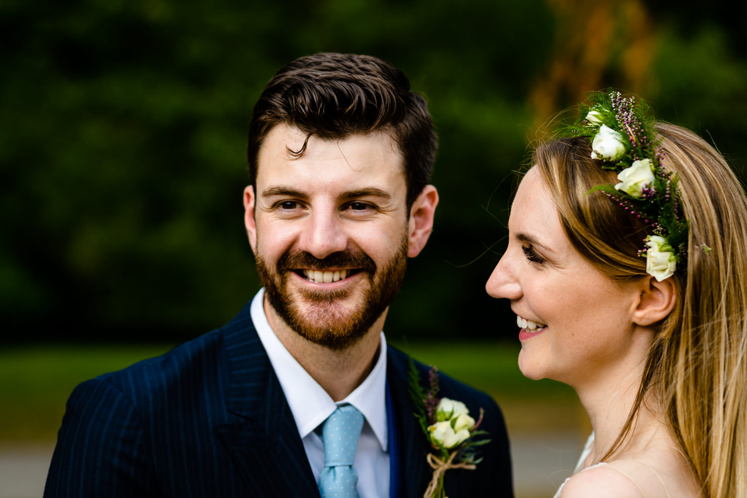 A bride smiles at her groom wedding photographers Whirlowbrook Hall Sheffield
