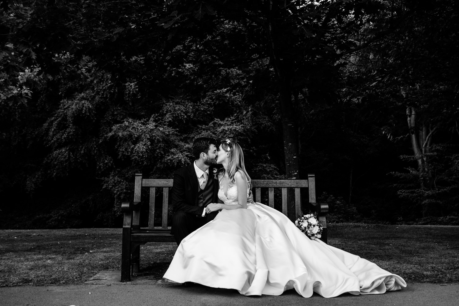 Romantic kiss between a bride and groom, wedding	photographer Whirlowbrook Hall Sheffield